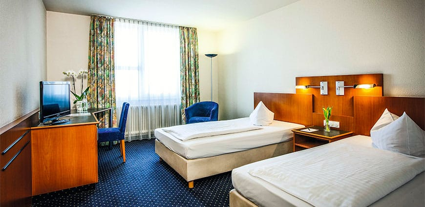 cmyk_hotel-arcadia-landsberg-room-twin-3-eisenberger-2014-lo-1-slider